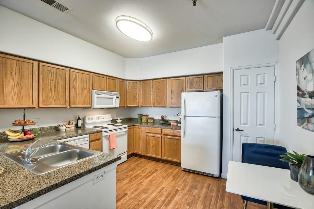 Kitchen at Vistas at Stony Creek Apartments in Littleton, Colorado