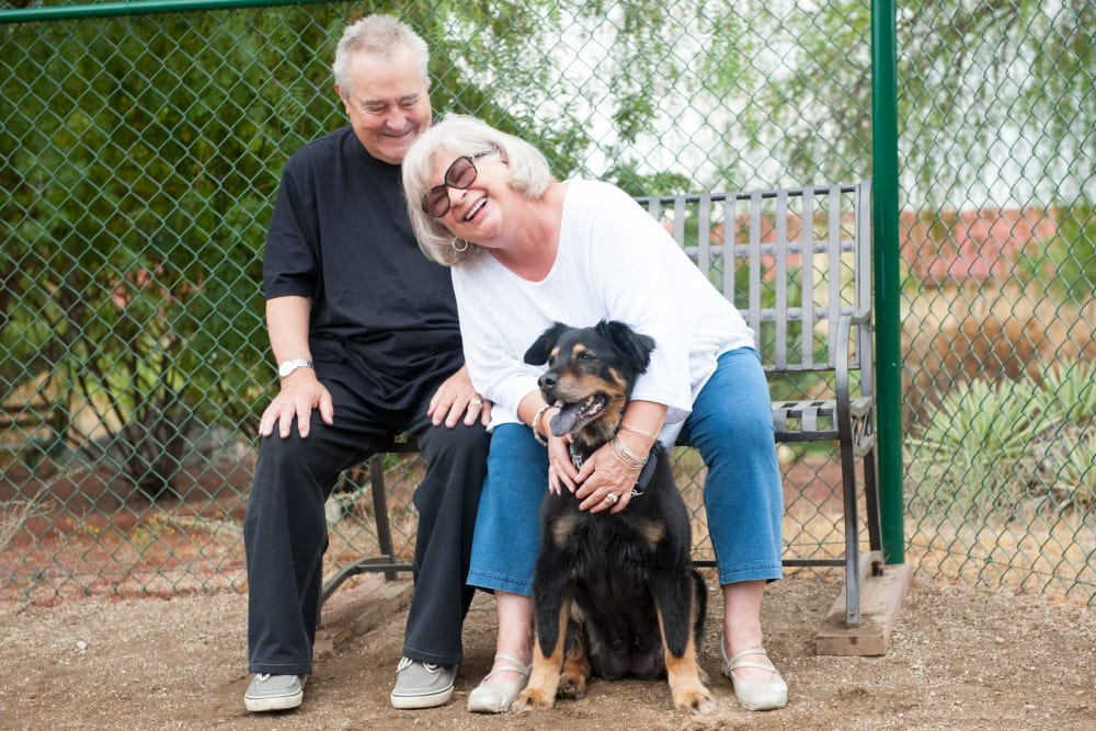 Two residents and their dog at Westmont Village in Riverside, California