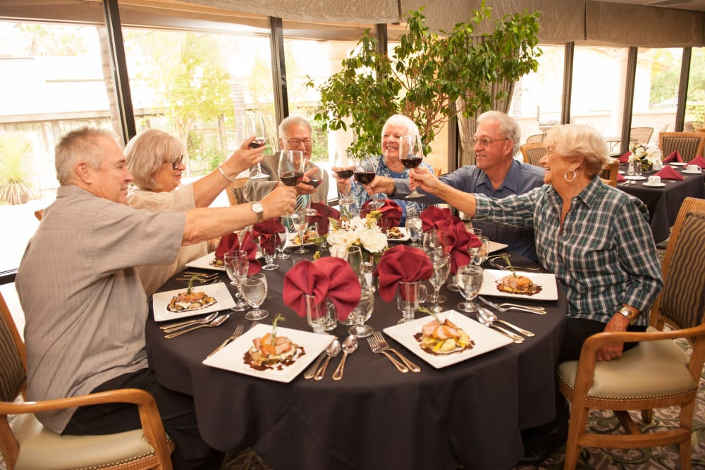 Group of residents sharing a meal at Westmont Village in Riverside, California