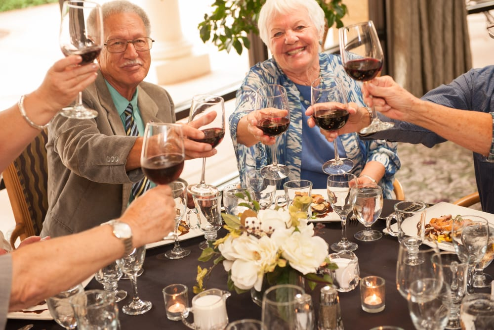 Residents enjoying a meal and glass of wine at Westmont Village in Riverside, California