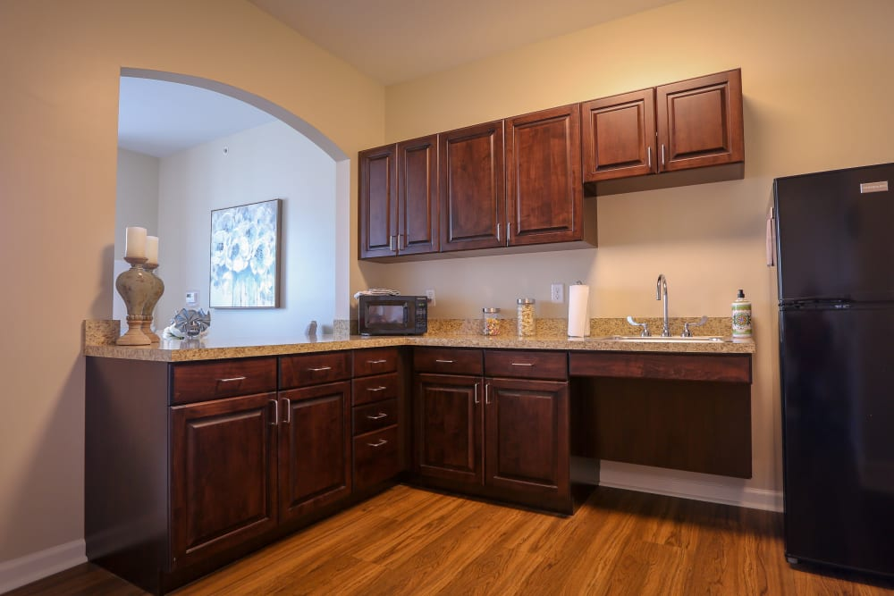 An apartment kitchen with wood flooring at Harmony at Martinsburg in Martinsburg, West Virginia