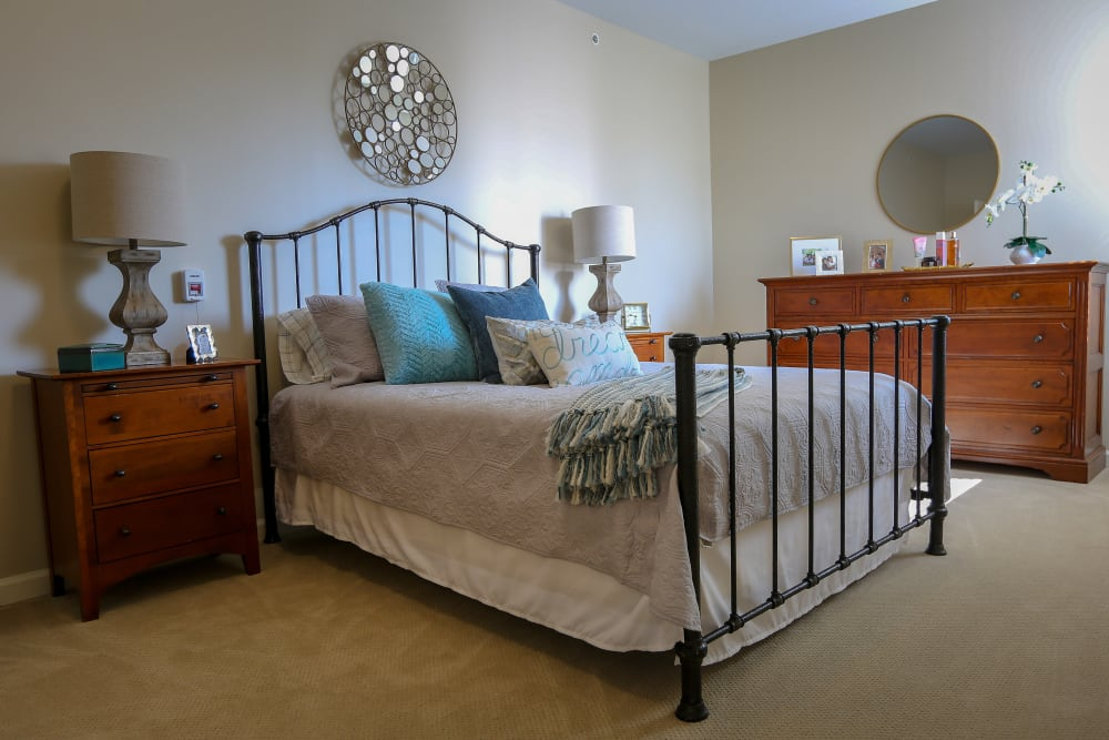 A spacious, furnished bedroom at Harmony at Martinsburg in Martinsburg, West Virginia