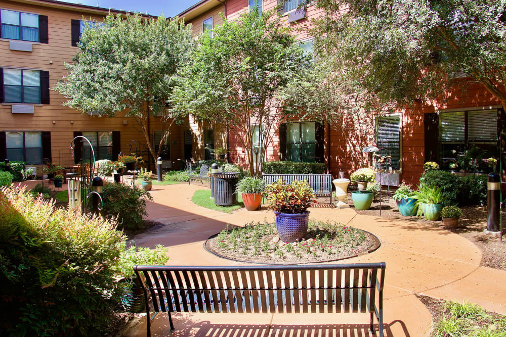 A large garden and patio area at Isle at Watercrest Bryan in Bryan, Texas