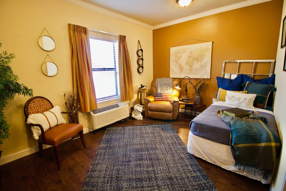 The bedroom of an apartment at Isle at Watercrest Bryan in Bryan, Texas