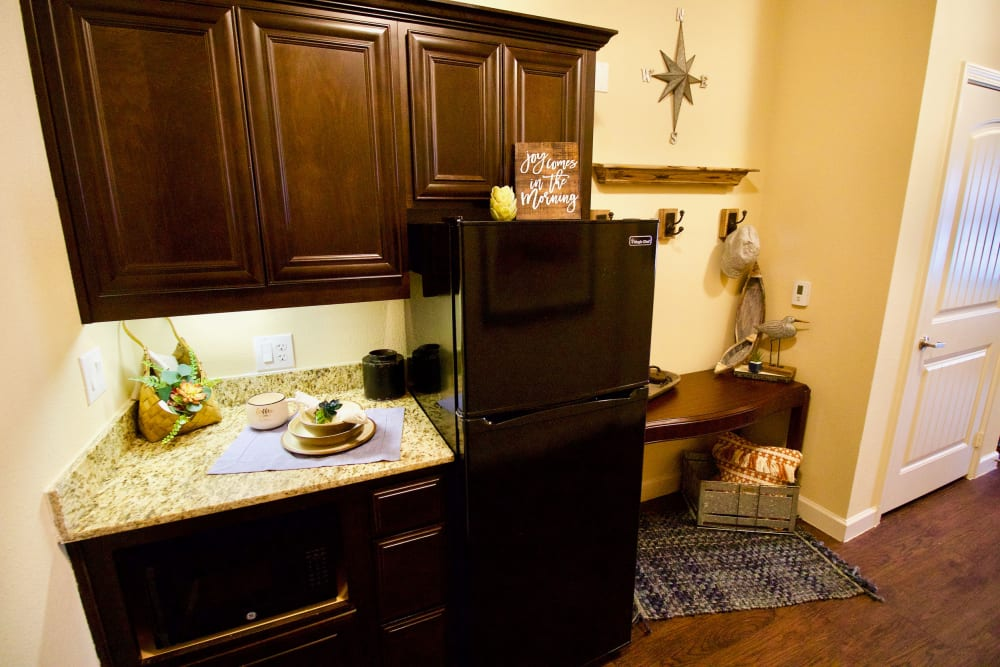 A kitchen in one of the apartments at Isle at Watercrest Bryan in Bryan, Texas