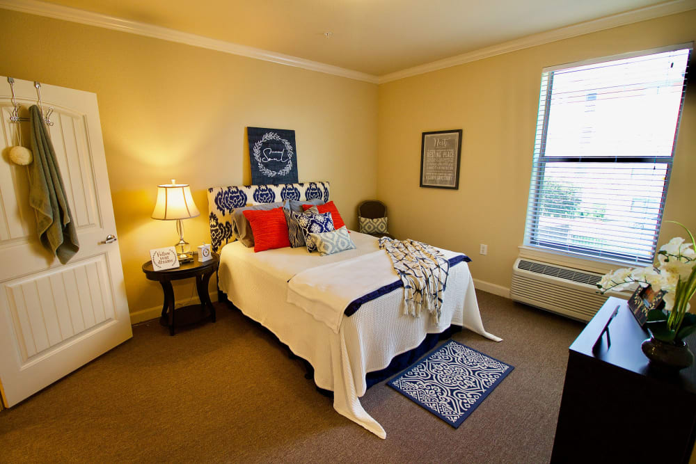 A fully furnished bedroom at Isle at Watercrest Bryan in Bryan, Texas