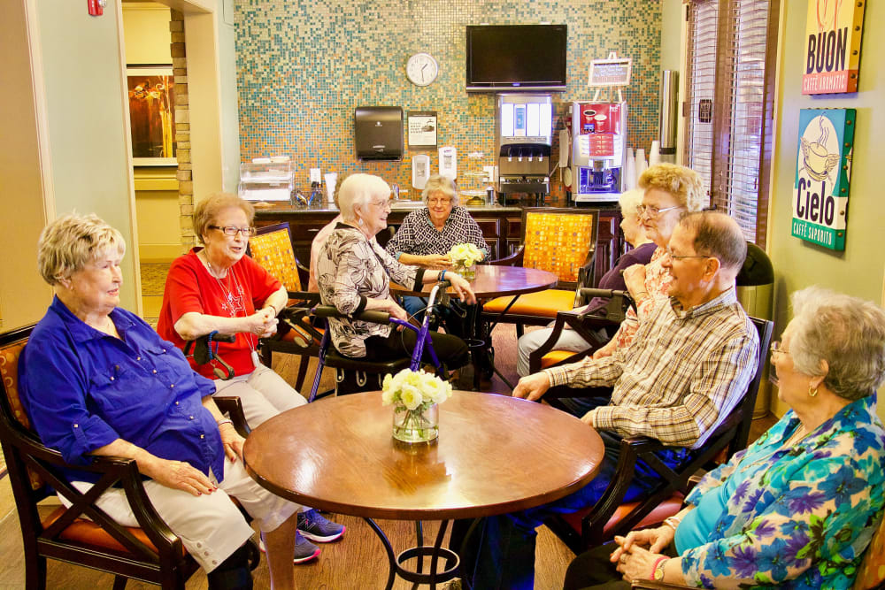 A room where residents are gathered for breakfast at Isle at Watercrest Bryan in Bryan, Texas