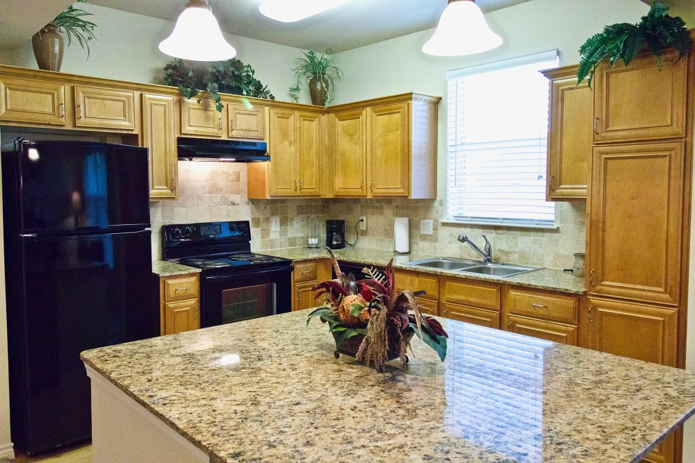 The kitchen of an apartment at Watercrest at Mansfield in Mansfield, Texas