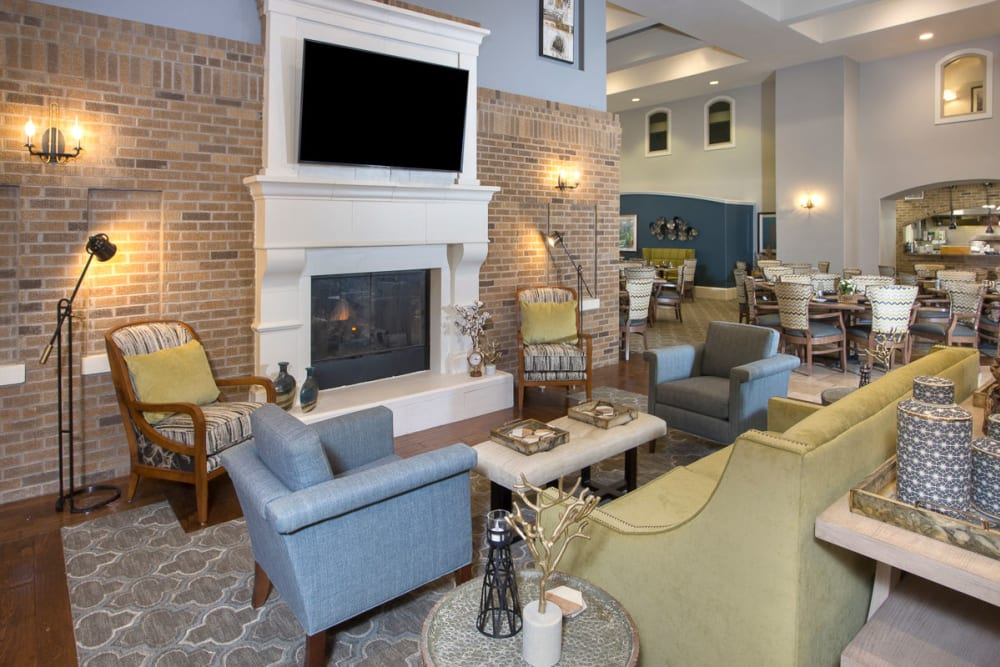 A hangout area with plenty of seating and a television at Raider Ranch in Lubbock, Texas