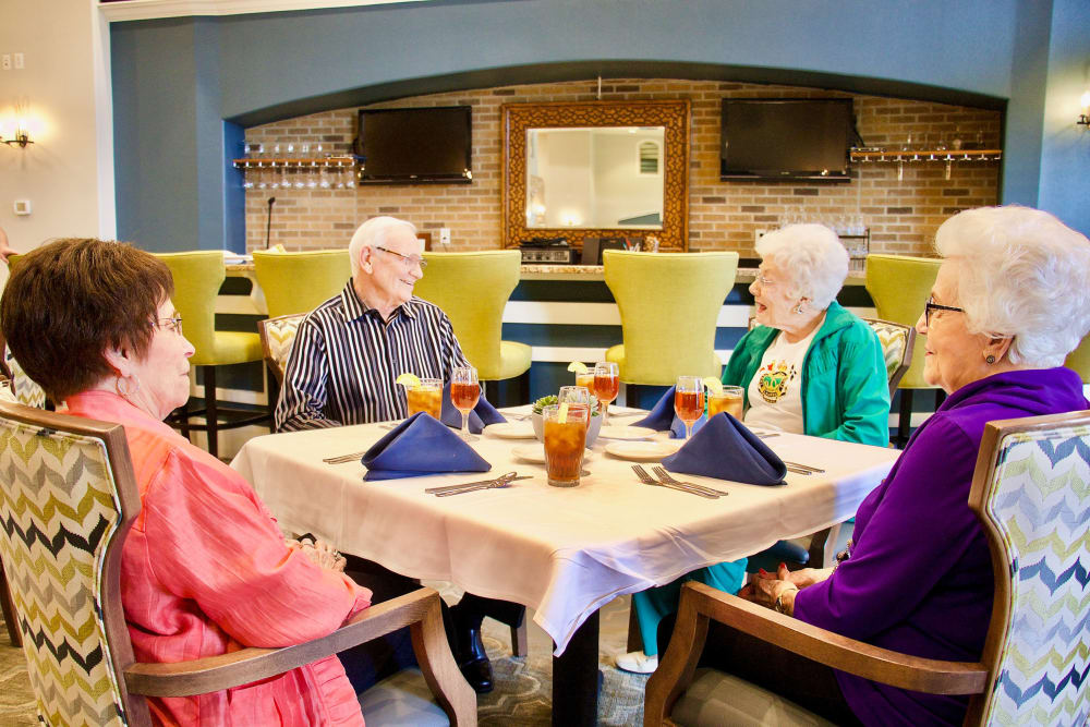 Residents sitting down for a meal at Raider Ranch in Lubbock, Texas