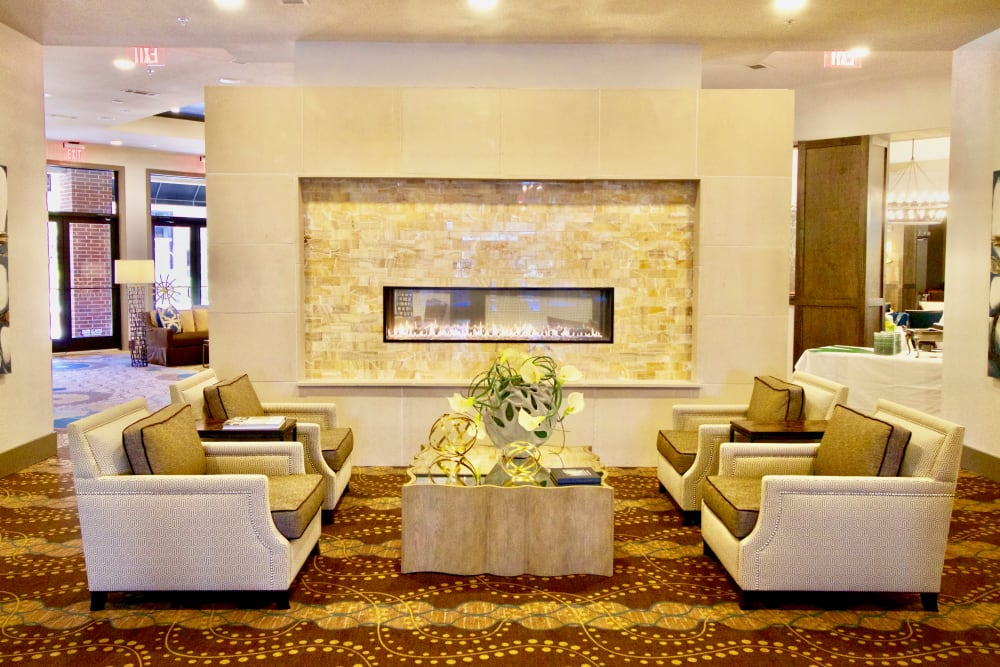 A lounge area with couches and decorations at Watermere at Woodland Lakes in Conroe, Texas