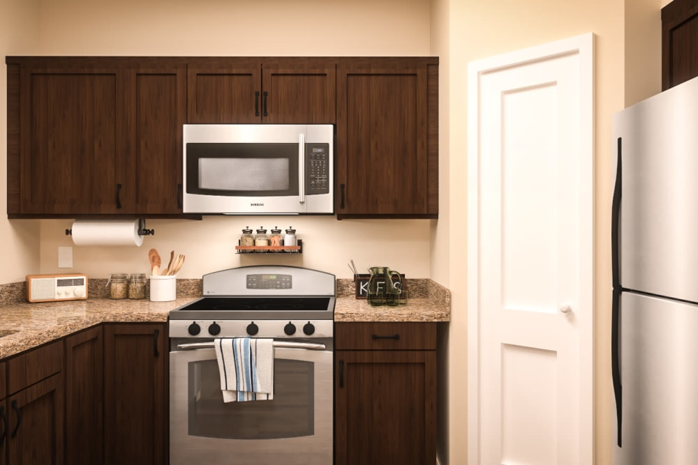 An apartment kitchen with stainless steel appliances at Harmony at Oakbrooke in Chesapeake, Virginia