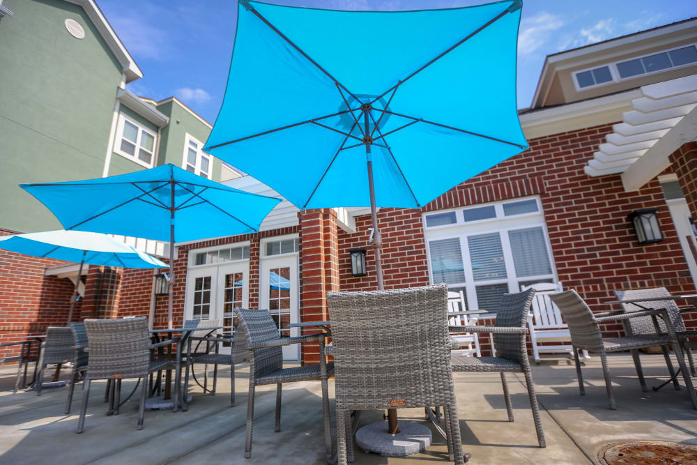 Covered outdoor seating on the patio at Harmony at Spring Hill in Lorton, Virginia
