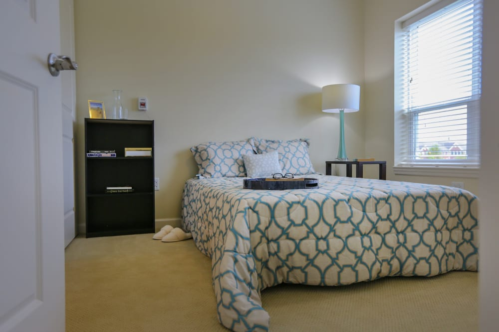 A spacious, decorated bedroom at Harmony at Spring Hill in Lorton, Virginia