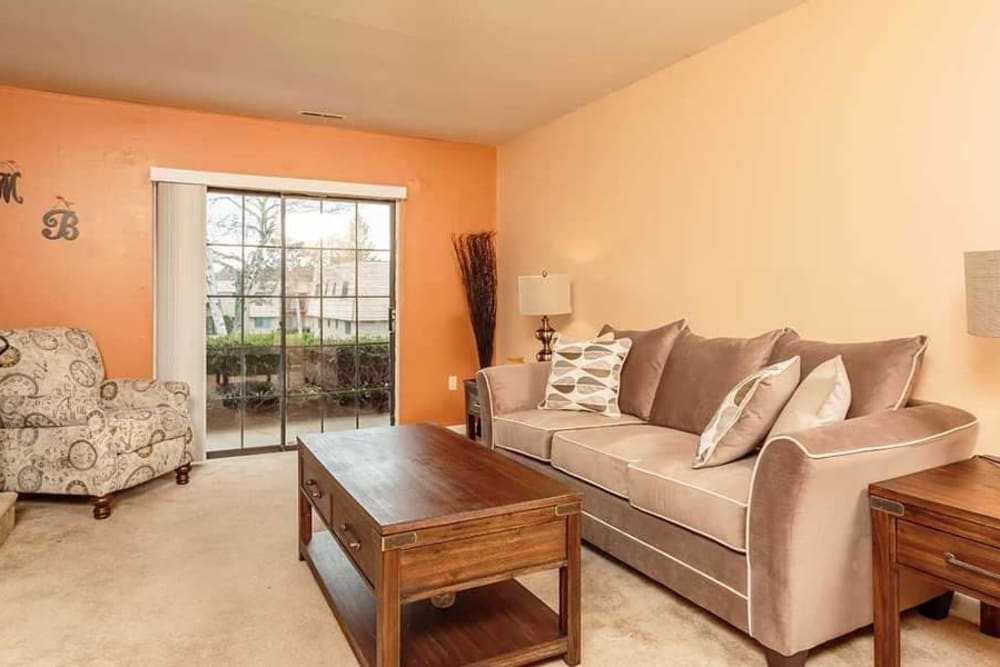 Gorgeous living room at Meadowbrook Apartments in Slingerlands, New York