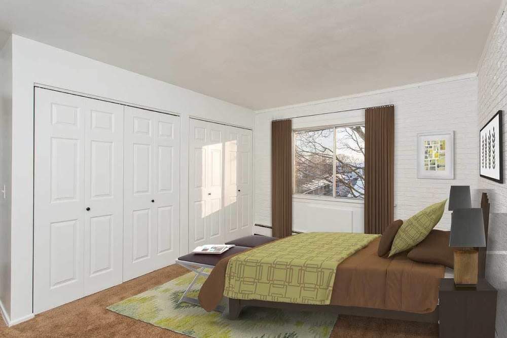 Well decorated master bedroom at Wedgewood West in Rochester, New York