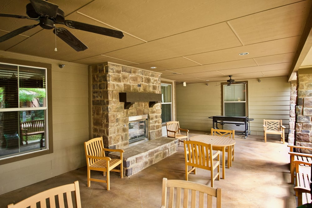 Outdoor seatinig with a fireplace at Isle at Watercrest Mansfield in Mansfield, Texas