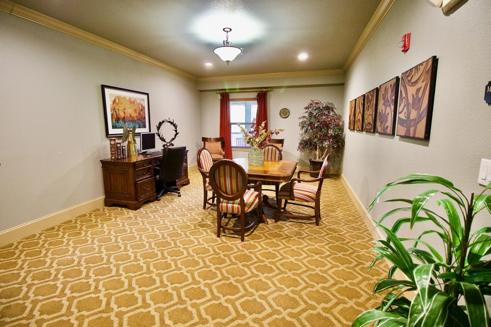 A conference room with fancy carpet at Isle at Watercrest Mansfield in Mansfield, Texas