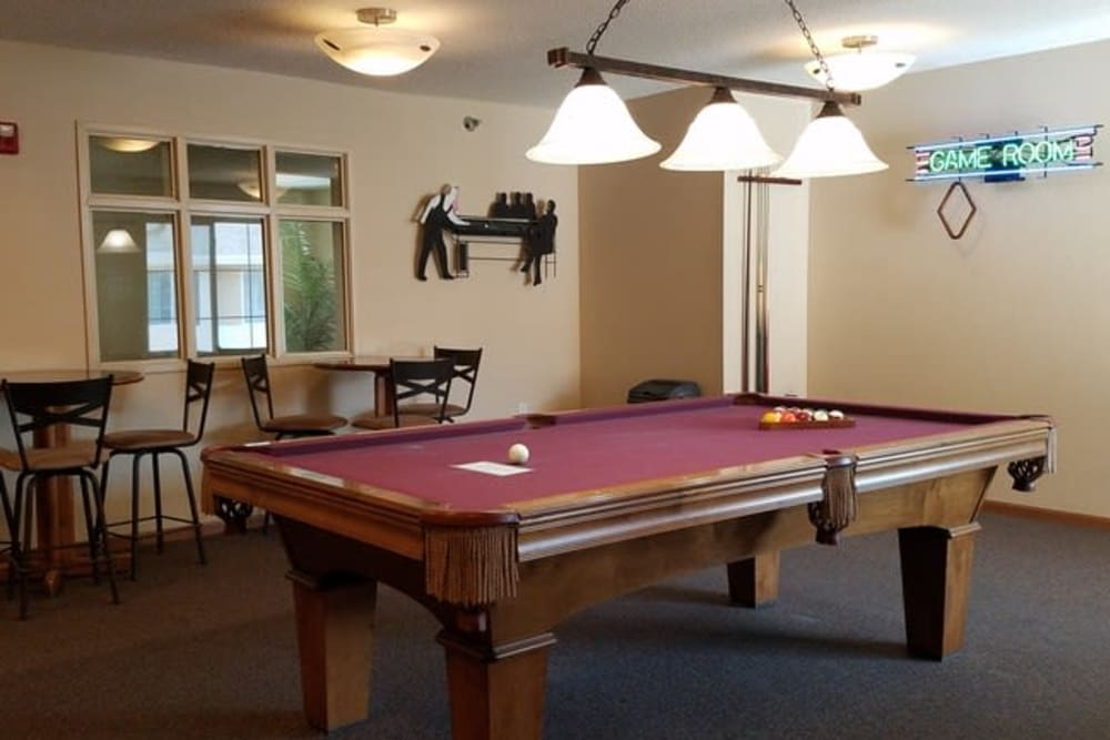 Billiards room with plenty of seating at Parkway Gardens Senior Apartment Community in Saint Paul, Minnesota