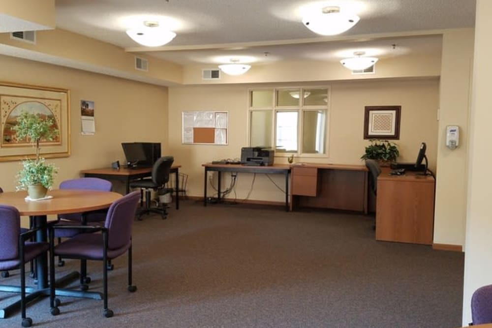 Spacious business center with ample lighting at Parkway Gardens Senior Apartment Community in Saint Paul, Minnesota