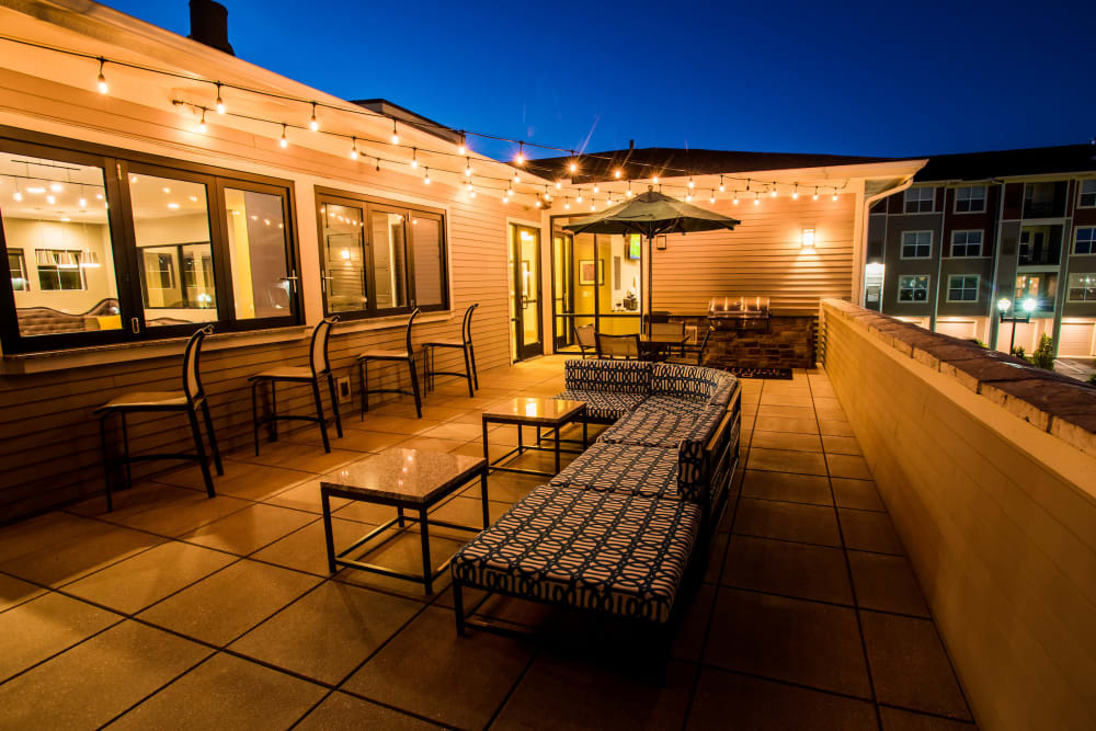Resident deck with night lighting and a grill Altitude 970 in Kansas City, Missouri.