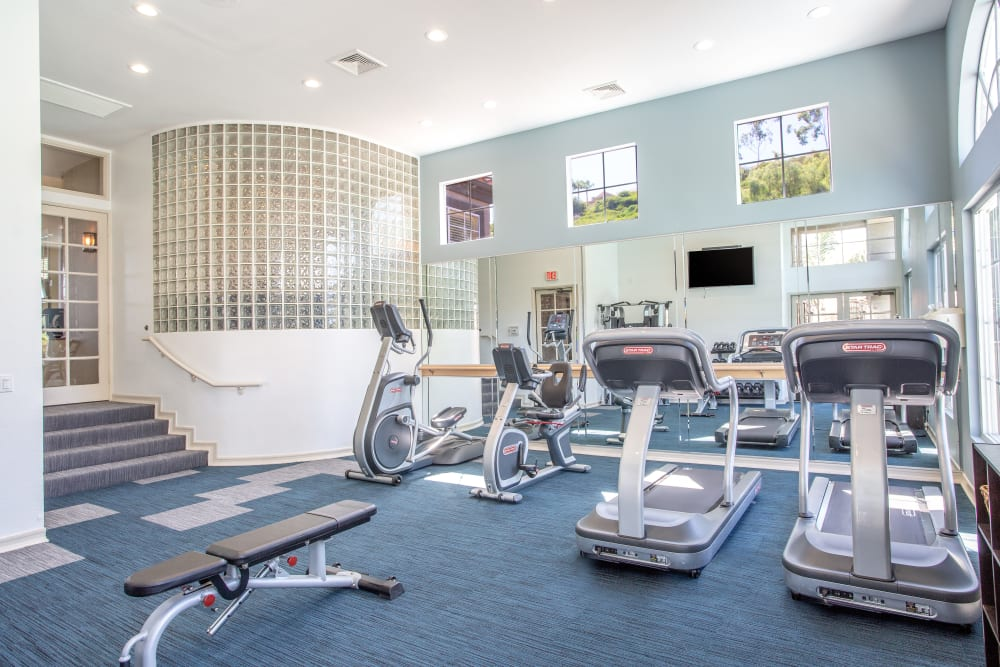 Fitness center with individual workout stations at Niguel Summit Condominium Rentals in Laguna Niguel, California