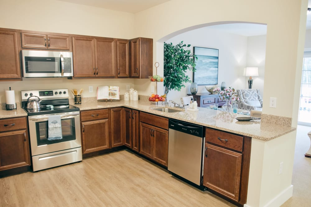 An apartment kitchen with stainless steel appliances at Harmony at West Ashley in Charleston, South Carolina