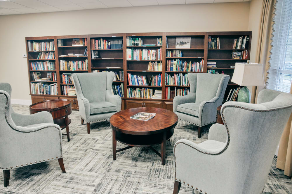 A library with cozy seating at Harmony at West Ashley in Charleston, South Carolina