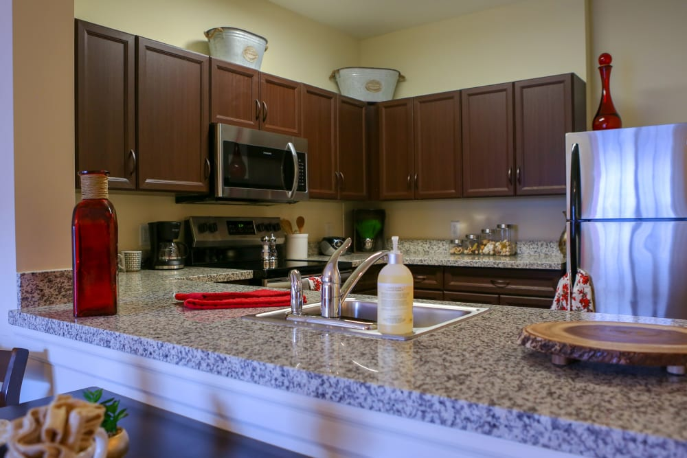 An apartment kitchen with stainless steel appliances at Harmony at West Shore in Mechanicsburg, Pennsylvania