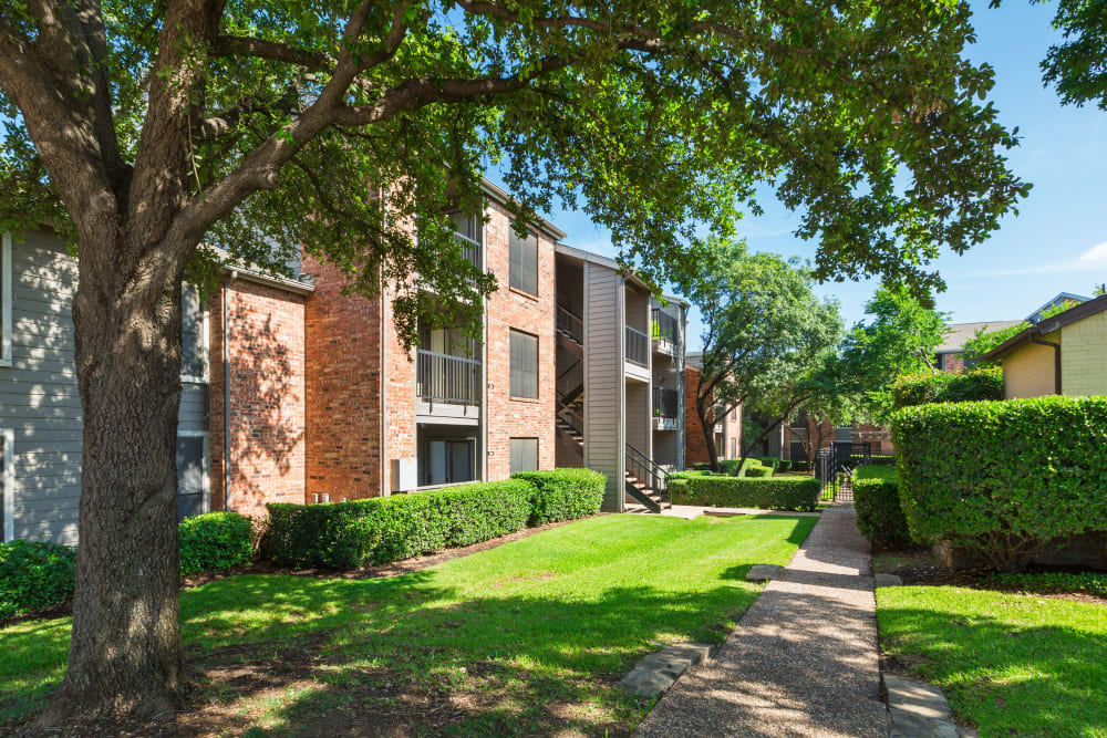View the exterior of apartments at Grayson Ridge in North Richland Hills, Texas