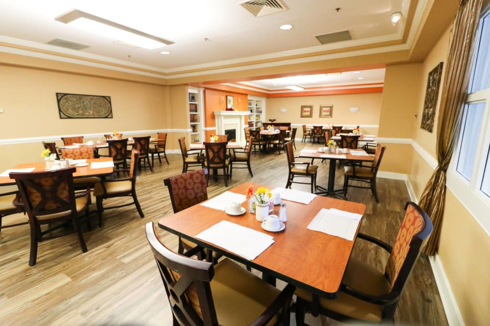 Set dining room tables at Harmony at Ironbridge in Chester, Virginia