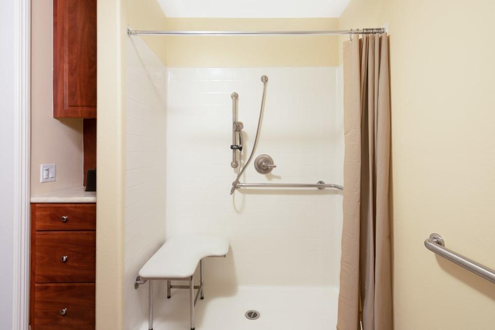 Bathroom with walk-in shower in a model unit at Vista Gardens in Vista, California