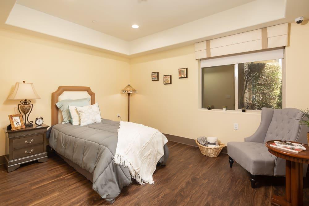 Bedroom in a model unit at Vista Gardens in Vista, California