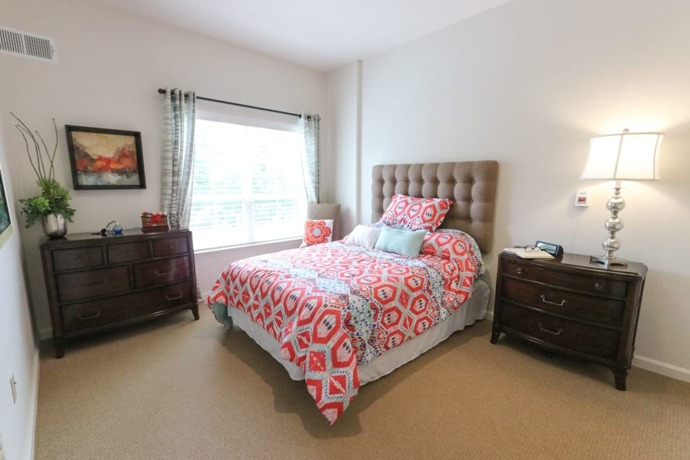 A furnished bedroom at Harmony on the Peninsula in Yorktown, Virginia