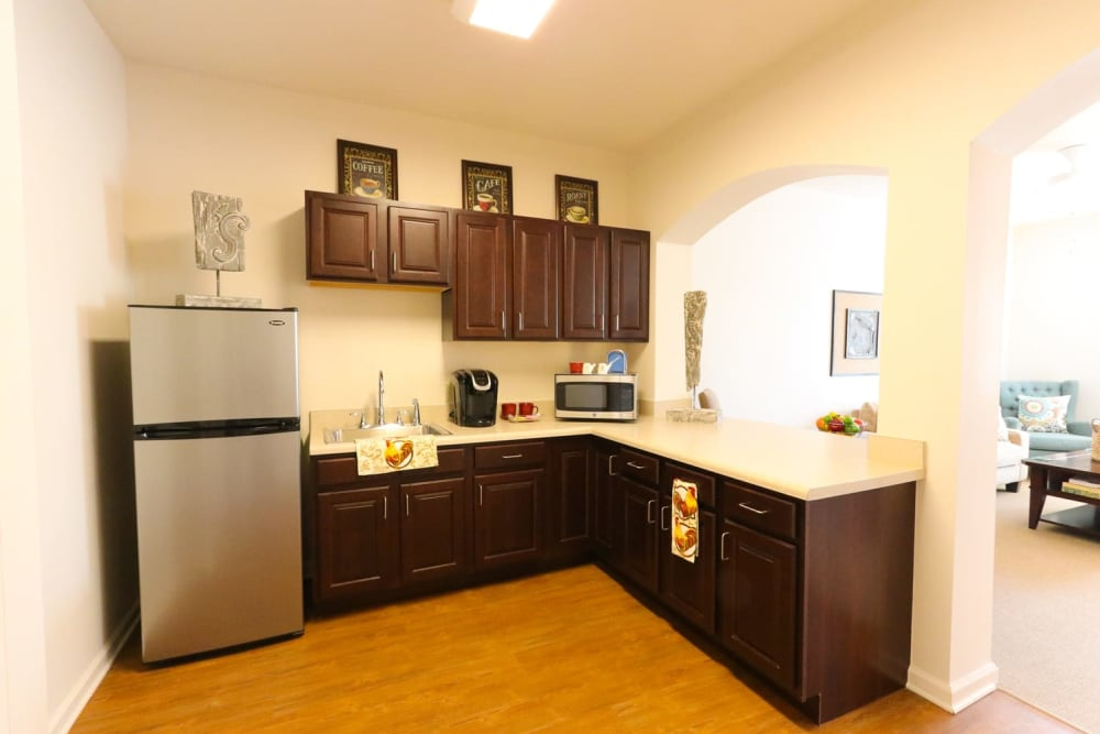 An apartment kitchen with stainless steel appliances at Harmony on the Peninsula in Yorktown, Virginia