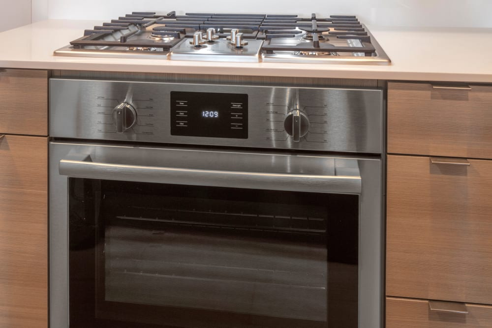 Modern stainless-steel gas range in a model home at TwentyTwenty Apartments in Portland, Oregon