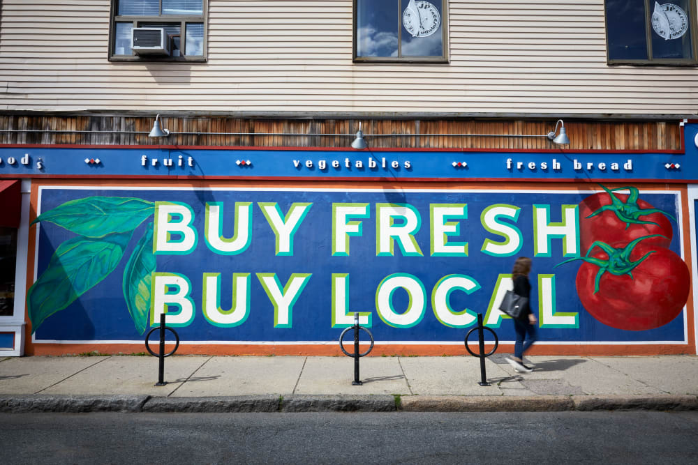 Buy fresh, buy local sign near Velō in Boston, Massachusetts