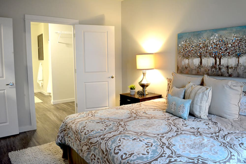 Master bedroom with a large walk-in closet at Pure St. Peters in Saint Peters, Missouri
