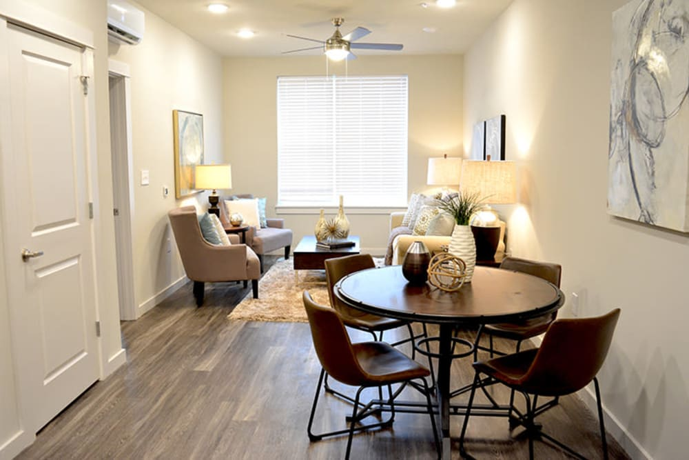 Open-floor concept with the dining room overlooking the living room at Pure St. Peters in Saint Peters, Missouri