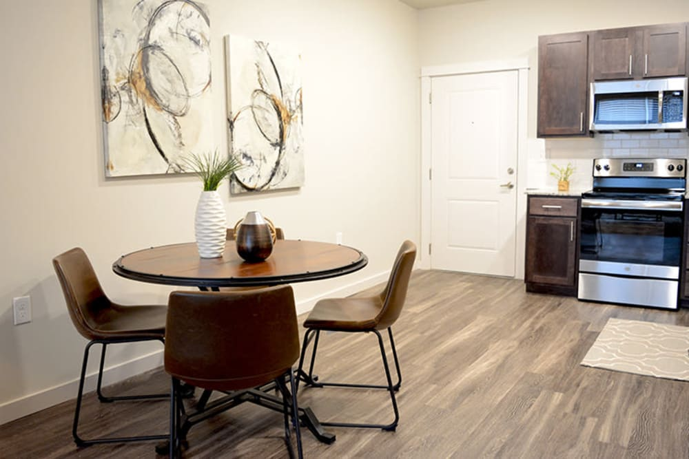 Open-concept floor plan with wood-style flooring at Pure St. Peters in Saint Peters, Missouri