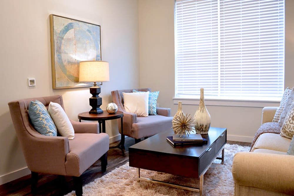 Living room with a large window for natural lighting at Pure St. Peters in Saint Peters, Missouri
