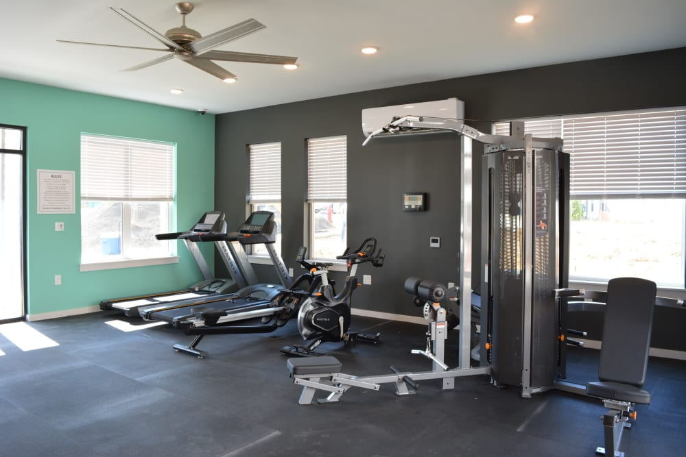 Gym with individual workout stations and a ceiling fan at Pure St. Peters in Saint Peters, Missouri