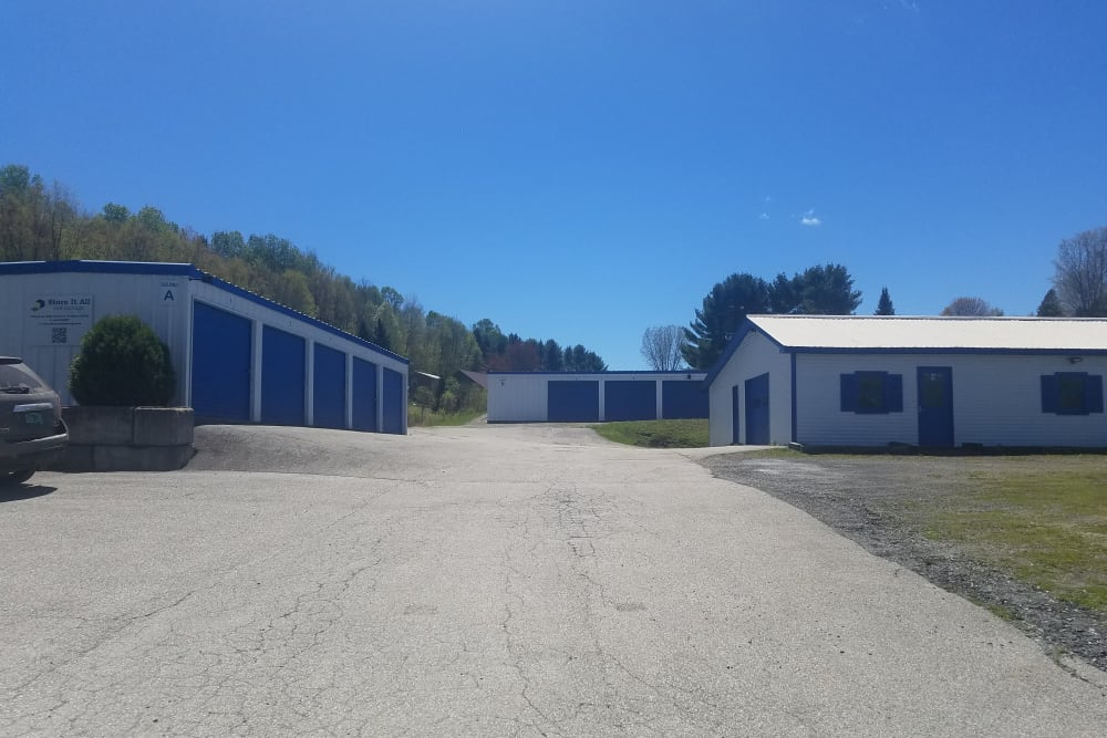 A wide driveway with storage units on either side at Store It All Self Storage - Barre in Barre, Vermont