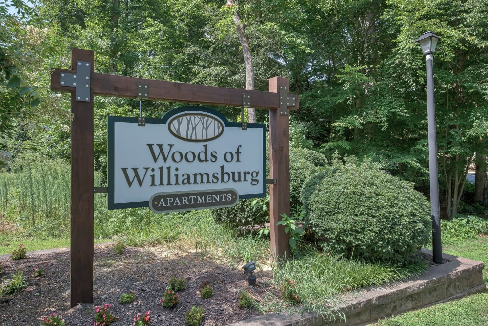 Entry Signage at Woods of Williamsburg Apartments in Williamsburg, Virginia