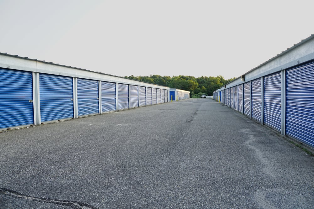A wide driveway with outdoor storage units at Store It All Self Storage - Lakeway in Lakeway, Texas