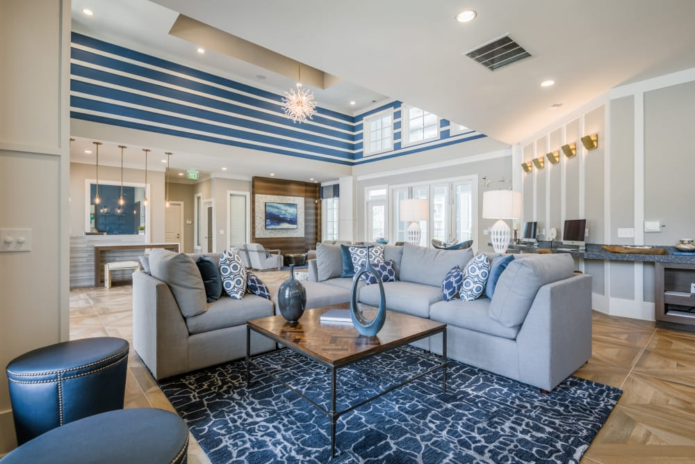 Community lounge with comfy couches at The Veranda at Market Common in Myrtle Beach, South Carolina