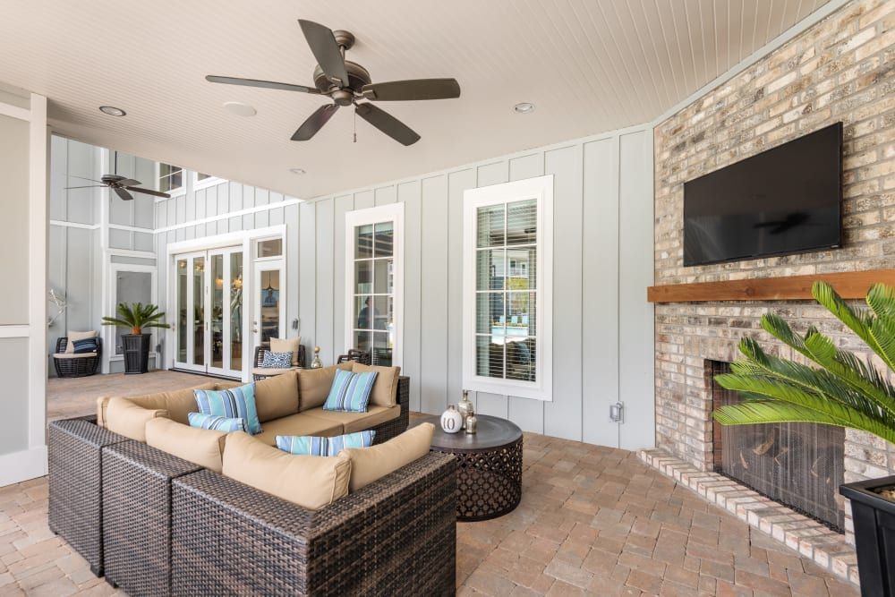 Outdoor lounge with TV by the pool area at The Veranda at Market Common in Myrtle Beach, South Carolina