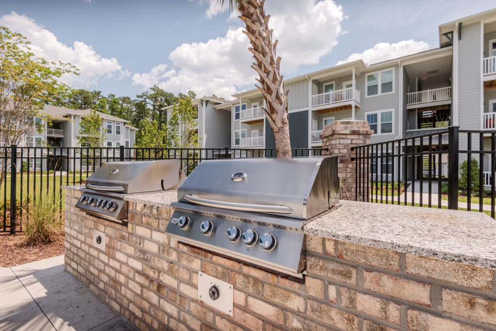 Stainless-steel BBQ grill by the pool at The Veranda at Market Common in Myrtle Beach, South Carolina