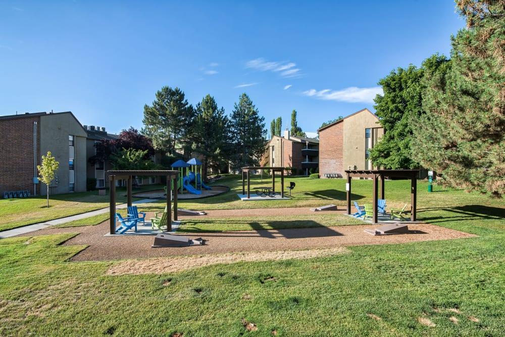Playground & Cornhole Area at Cherry Creek Apartments in Riverdale, Utah