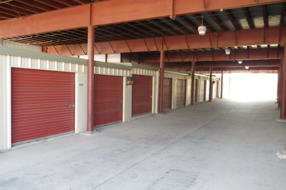 A large covered driveway with storage units on either side at Store It All Self Storage - Westlake in Austin, Texas